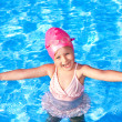 Stock Photo: Thumb up of kid in swimming pool.