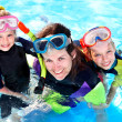 Children in swimming pool learning snorkeling. - Stock Photo