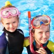Stock Photo: Children in swimming pool learning snorkeling.