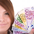 Happy woman with group of money. — Stock Photo