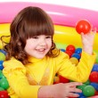Child in group colourful ball. — Stock Photo
