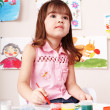 Child with picture and brush in play room. — Stock Photo #6140341