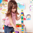 Child playing construction set in play room. — 图库照片