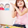 Child glue paper in preschool. Child care. — Stock Photo