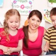 Children with teacher in play room. — Stock Photo #6140373