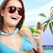 Girl in bikini drinking cocktail. — Stock Photo