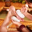 Woman getting foot massage in bamboo spa. - Stock Photo