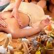 Woman getting massage in bamboo spa. — Stock Photo #6140892