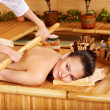 Bamboo massage. - Stock Photo