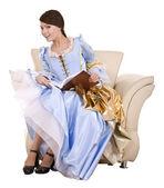 Sandalye üzerinde kitap ile elbise kız mavi milano içinde. — Stok fotoğraf