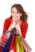 Flicka håller gruppen shoppingväska. — Stockfoto