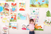 Child in art class with picture. — Stockfoto