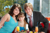 Happy family with child in cafe. — Foto de Stock
