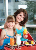 Mother and daughter in restaurant. — Stock Photo