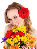 Young woman holding flowers. — Stock Photo