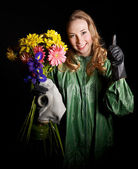 Woman holding flowers and gas mask . — Stock Photo