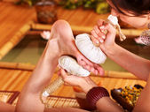 Woman getting foot massage in bamboo spa. — Stock Photo