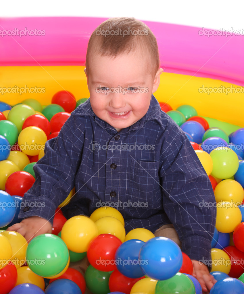Birthday of fun boy in color balls. — Stock Photo #6140227