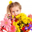 Happy child holding flowers. — Stock Photo