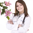 Doctor with stethoscope and flower. — Stock Photo #6256750
