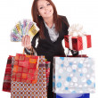 Royalty-Free Stock Photo: Woman holding money, gift box and shopping bag.