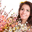 Young woman with spring flower and butterfly. — Stock Photo