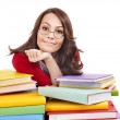 Girl in glasses with stack book . — Stock Photo