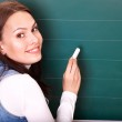 Student writing on blackboard. — Stock Photo