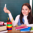 Stock Photo: Teacher writing on blackboard.