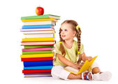 Child reading pile of books. — Stock Photo