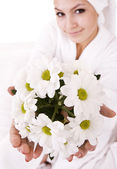 Girl with camomile and white towel on head . — Stock Photo
