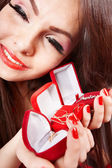 Girl with group jewellery box on red background. Valentines day. — Stock Photo