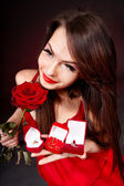 Woman holding gift on Valentine's Day . — Stock Photo