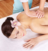 Young woman on massage table in beauty spa. Series. — Stock Photo