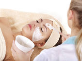 Beautician applying facial mask — Stock Photo