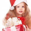 Royalty-Free Stock Photo: Child  in red santa hat holding gift box.