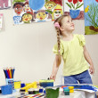 Foto de Stock  : Child painting in preschool.