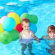 Royalty-Free Stock Photo: Children playing with balloons in swimming pool.