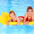 Kids swimming on inflatable beach mattress. — Stock Photo #6335626
