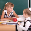 Schoolchildren in classroom near blackboard. — Stock Photo #6335671