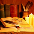 Stock Photo: Stack old book and candle.