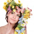 Stock Photo: Girl with butterfly and flower on head.