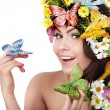 Girl with butterfly and flower on head. — Stock Photo