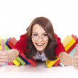 Thumb up of girl in glasses with stack book . — Stock Photo #6336546