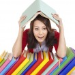 Stock Photo: Girl with pile color book .