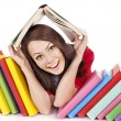 Girl with stack color book. — Stock Photo #6336560