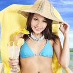 Girl in bikini drinking cocktail. — Stock Photo #6336568