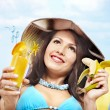 Girl in bikini with banana and cocktail. — Stock Photo #6336572