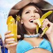 Girl in bikini with banana and cocktail. — Stock Photo #6336574