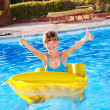 Child sitting on inflatable ring thumb up. — Stock Photo #6336669